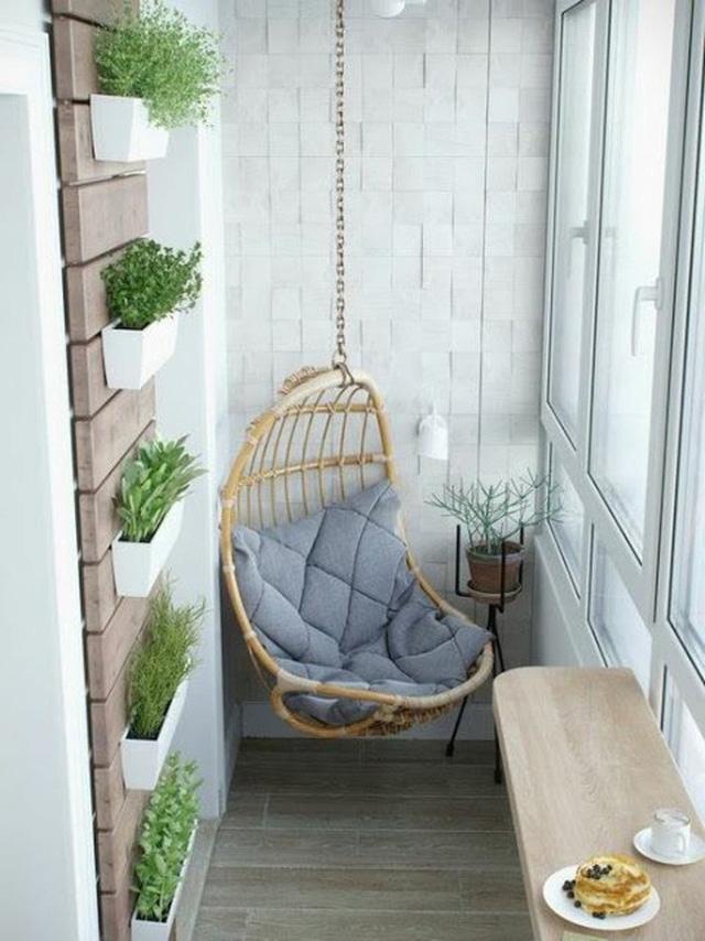 Chỉ cần một chiếc sofa treo và một chiếc bàn nhỏ bạn đã có một góc thưởng thức trà, café lý tưởng ngay tại ngôi nhà của mình.